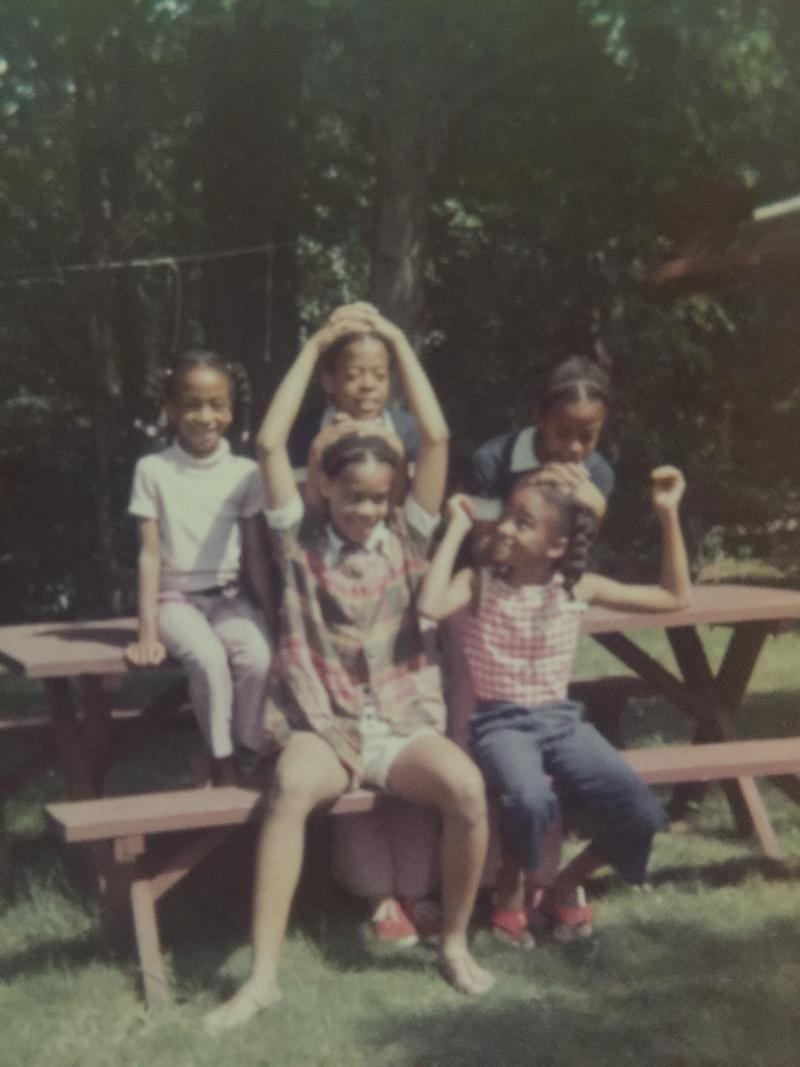 Bottom row: Natalie and cousin Munchy. Top row: Leslie and Laurie with cousin Kim, at a family gathering in Battlecreek, MI. (1972)