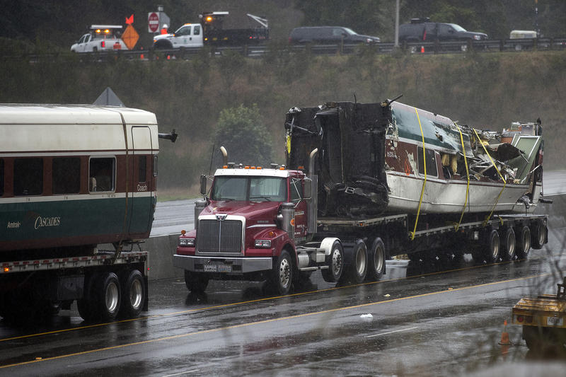 A damaged train car is shown on the bed of a truck along I-5 South on Tuesday, December 19, 2017, in Dupont.
