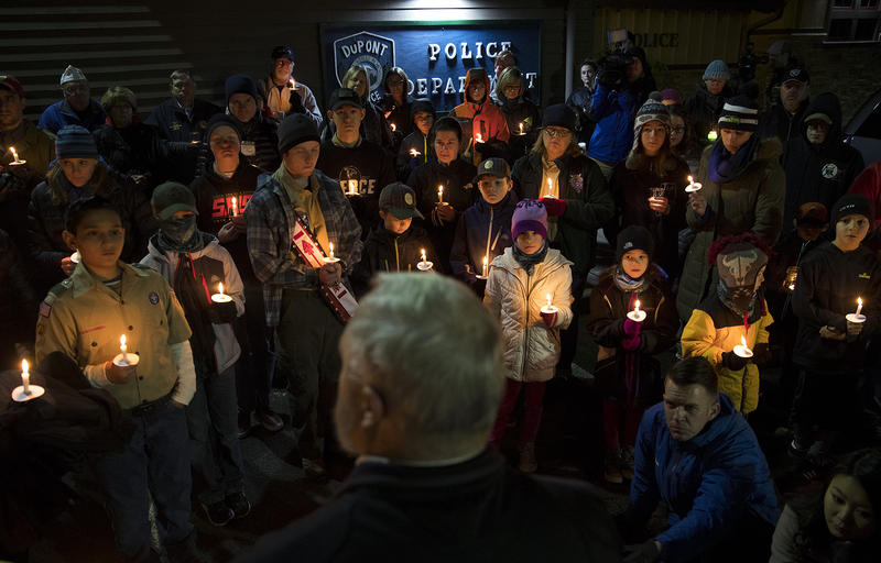 Members of the DuPont community gather to listen to mayor Mike Courts during a candlelight vigil on Wednesday, December 20, 2017, at DuPont City Hall in DuPont.