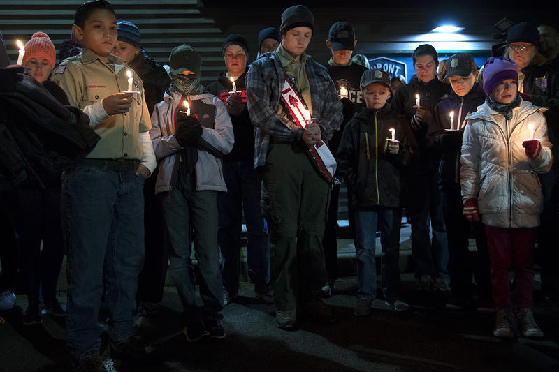 Members of the DuPont community gather for a candlelight vigil to honor the victims of the derailed Amtrak train on Wednesday, December 20, 2017, at DuPont City Hall in DuPont.