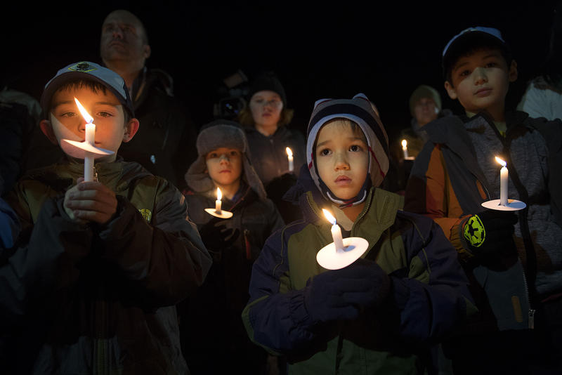 Liam Gallahan, 6, center right, and Aiden Gendron, center left, stand with other members of Cub Spouts Pack #472 during a candlelight vigil to honor the victims of the derailed Amtrak train on Wednesday, December 20, 2017, at DuPont City Hall in DuPont.