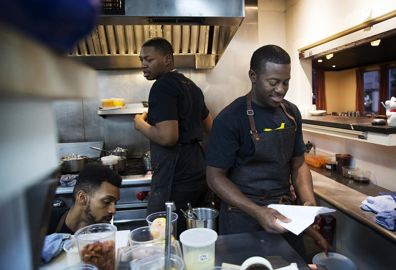 Edouardo Jordan, right, works in the kitchen at JuneBaby on Wednesday December 6, 2017, in Seattle.