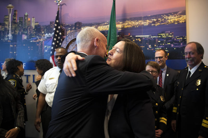 Tim Burgess hugs Seattle Police Chief Kathleen O'Toole after a press conference on Monday, December 4, 2017, at Seattle City Hall.