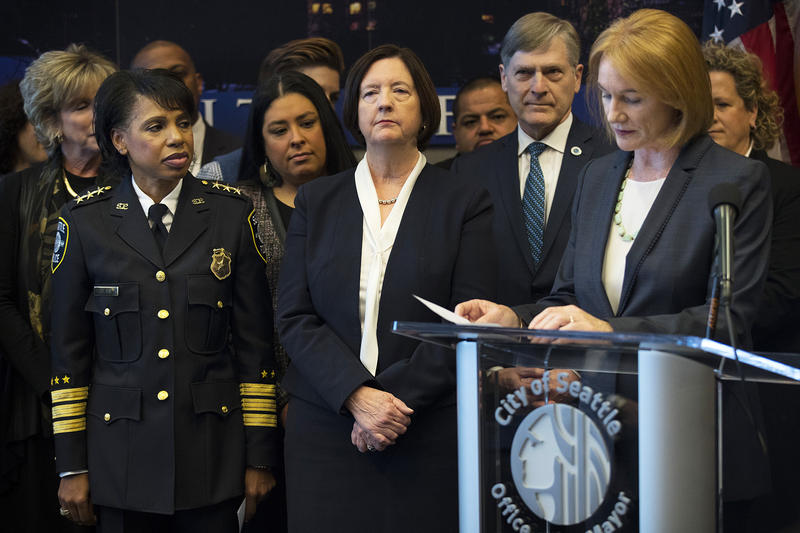 Deputy Chief Carmen Best, left, and Seattle Police Chief Kathleen O'Toole listen as Mayor Jenny Durkan speaks during a press conference on Monday, December 4, 2017, at Seattle City Hall.