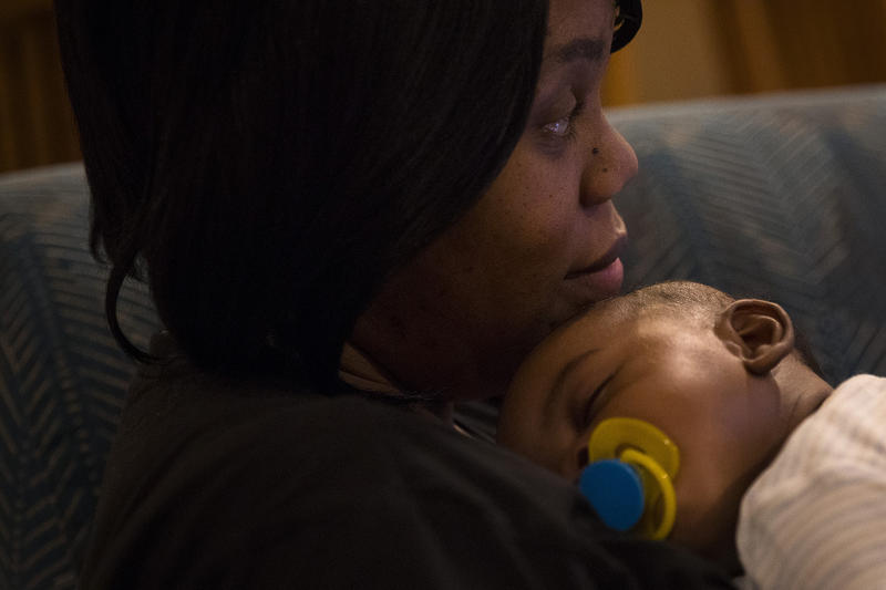 Tiffany Hicks holds her 4-month-old son Elijah, on Wednesday, December 13, 2017, at their apartment in Auburn.