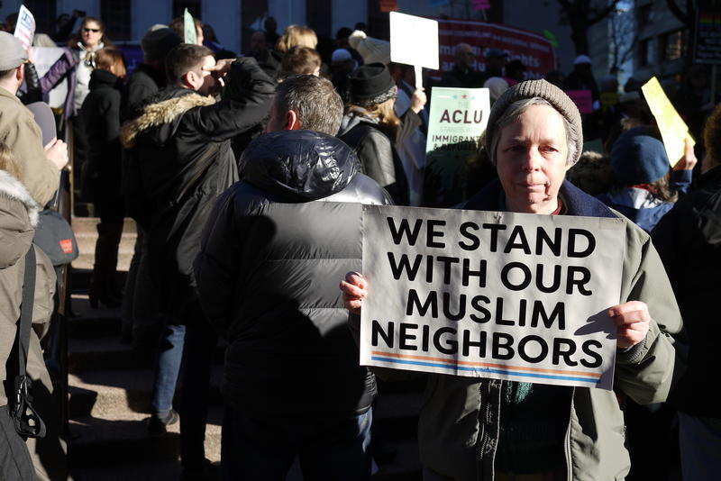 FILE: Therese Macisaac of Seattle joins a protest against the travel ban outside the U.S. District Court of Appeals in Seattle in 2017.