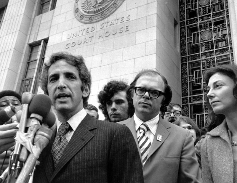 Daniel Ellsberg (left) and co-defendant Anthony Russo talk to news reporters outside the Federal Building in Los Angeles on Jan. 17, 1973, during the Pentagon Papers trial.