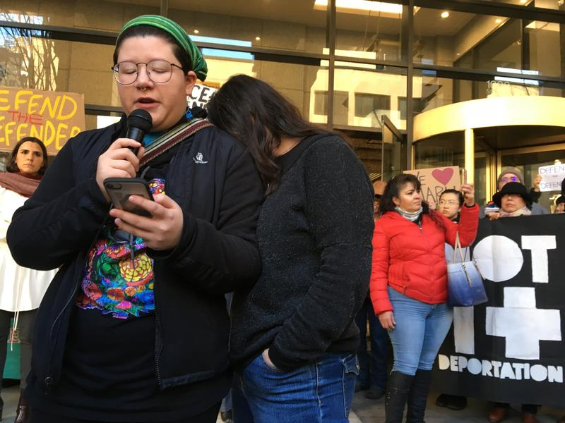 Josefina Mora, left, speaks about her mother's deportation case at news conference in January, 2018 outside the Seattle Immigration Court. Her mother, Maru Mora-Villalpando, buries her head on her shoulder as both women fight back tears.