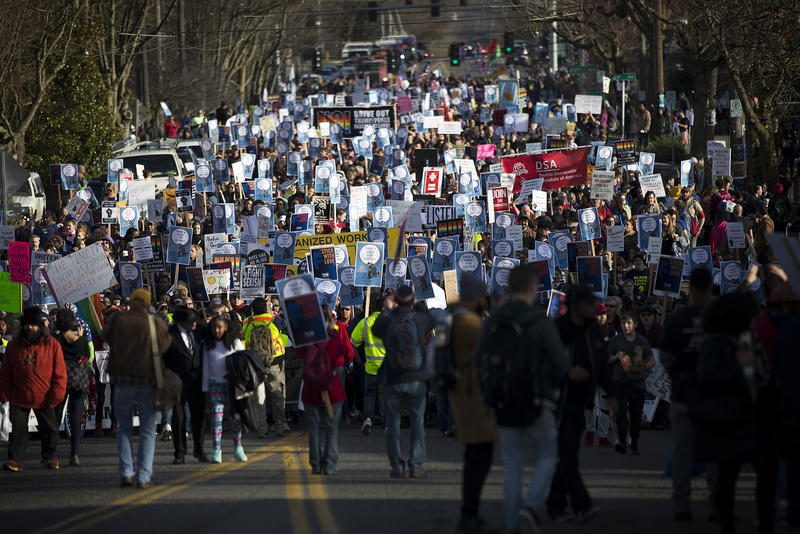 Demonstrators make their way from Garfield high school to Westlake Park during the annual Martin Luther King Jr. Day march on Monday, January 15, 2018, in Seattle.