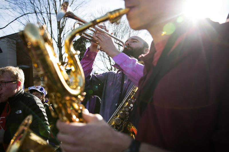 Rise Up! Action Band member Ben Brooks plays the trumpet during the annual Martin Luther King Jr. Day march on Monday, January 15, 2018, in Seattle.