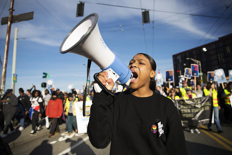 Angelia Bland, 15, leads a chant during the annual Martin Luther King Jr. Day march on Monday, January 15, 2018, in Seattle.