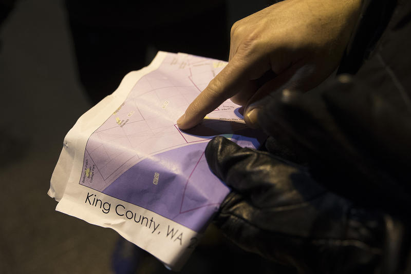 Adam Hasson checks the map during the annual King County Point-In-Time count on Friday, January 25, 2018, in Seattle.