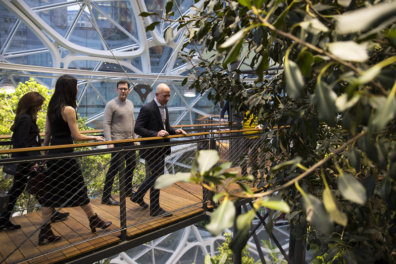 Jeff Bezos, right, tours The Spheres on Monday, January 29, 2018, during the grand opening in Seattle.