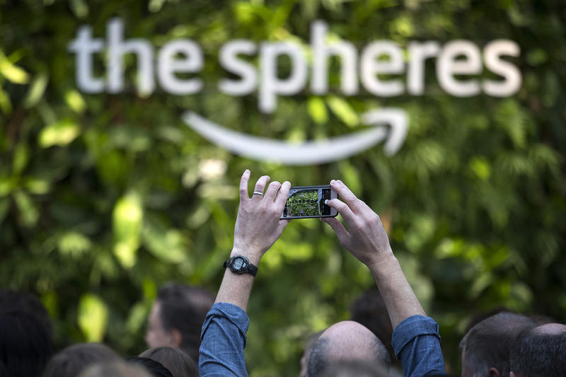 A guest takes a photograph on Monday, January 29, 2018, during the Amazon spheres grand opening in Seattle.