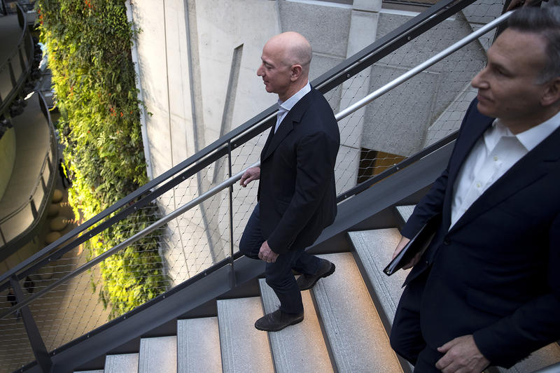 Jeff Bezos walks with King County Executive Dow Constantine, right, on Monday, January 29, 2018, during the Amazon spheres grand opening in Seattle.