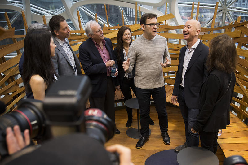 Jeff Bezos, right, laughs while touring the Amazon spheres on Monday, January 29, 2018, during the spheres grand opening in Seattle.