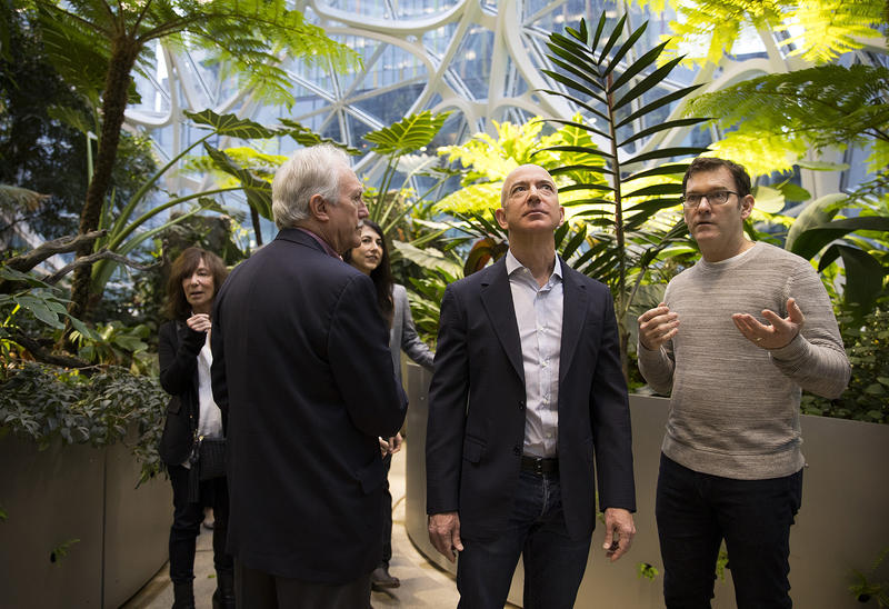 Jeff Bezos, center, tours the Amazon spheres on Monday, January 29, 2018, during the spheres grand opening in Seattle.