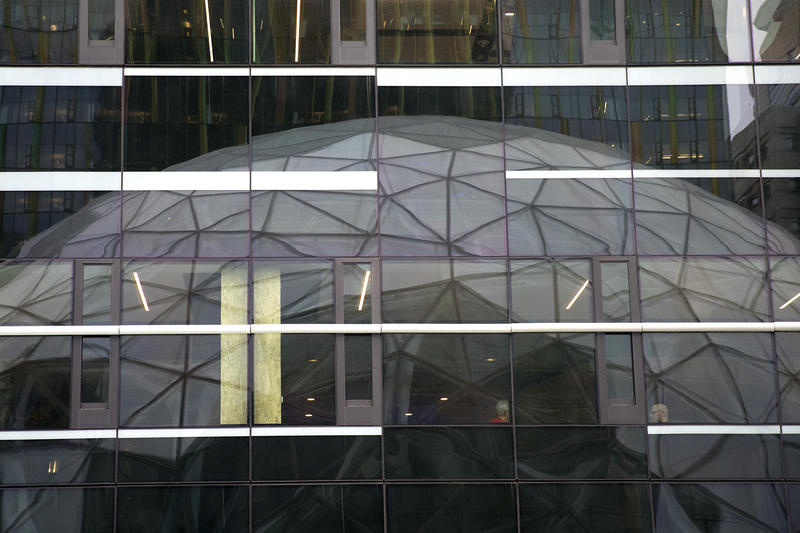 The Amazon Spheres are reflected in the Amazon Doppler building on Monday, January 29, 2018, during the spheres grand opening in Seattle.