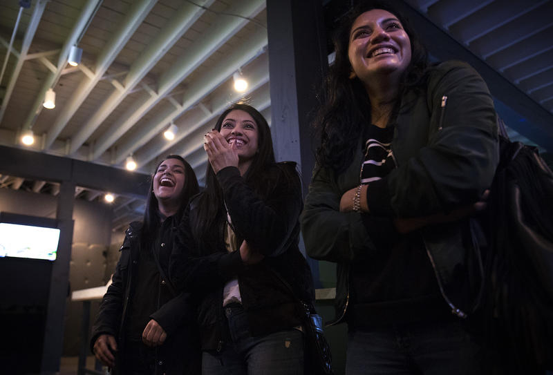 From left, Harleen Kaur, Amy Kaur and Brenda Palomino laugh as they watch friends play virtual reality games on Friday, November 17, 2017, at Portal Virtual Reality Arcade and Lounge in Seattle.