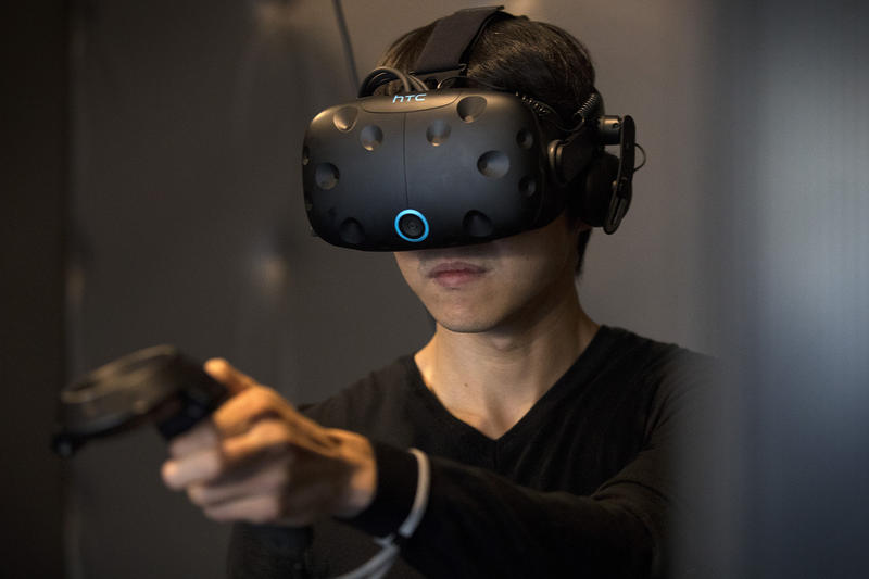 Kai Kao plays a virtual reality game on Friday, November 17, 2017, at Portal Virtual Reality Arcade and Lounge in Seattle.