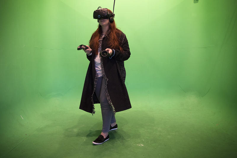 Rachel Booth plays a virtual reality game on Friday, November 17, 2017, at Portal Virtual Reality Arcade and Lounge in Seattle.