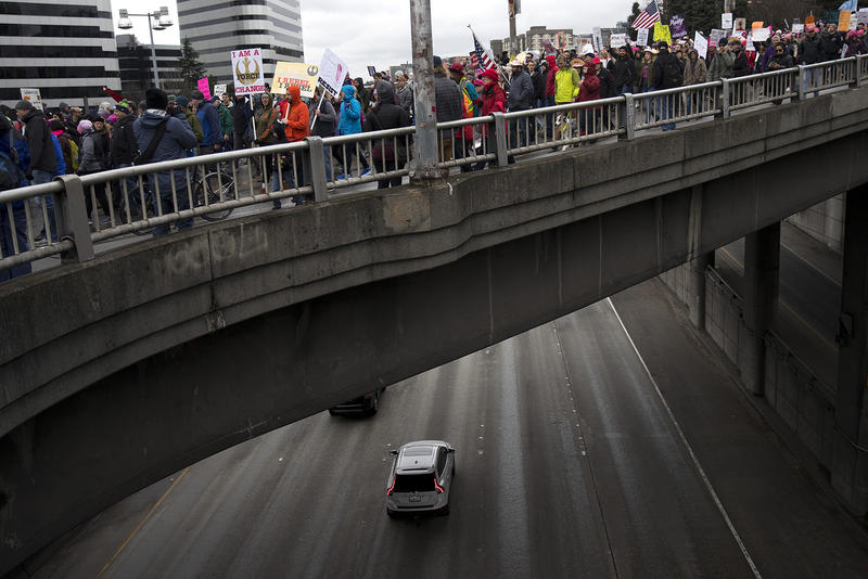 Thousdands march on Pine St. during the Women's March on Saturday, January 20, 2018, in Seattle.