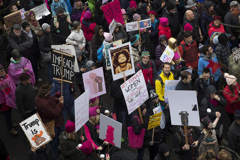Thousands march on Pine St., during the beginning of the Women's March on Saturday, January 20, 2018, in Seattle.