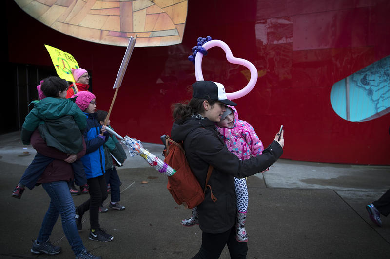 Lindsey Eason takes a selfie with her 4-year-old daughter Juniper Eason during the Women's March on Denny Way on Saturday, January 20, 2018, in Seattle.