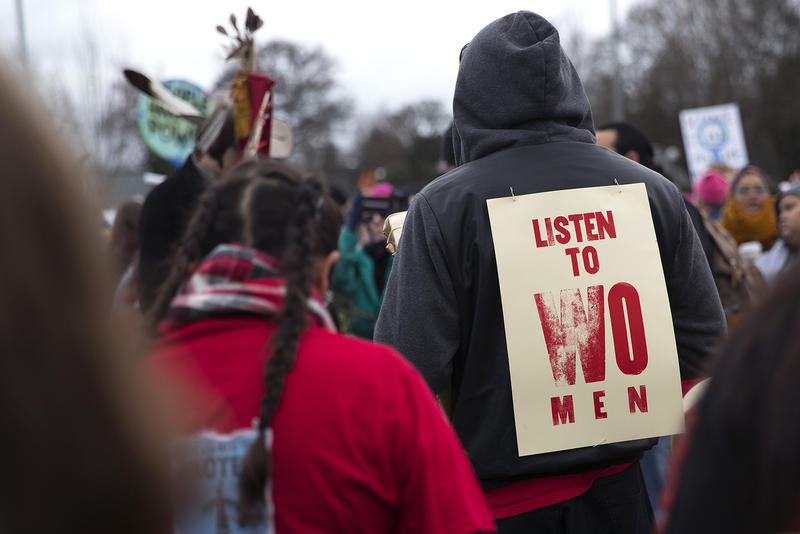 A crowd gathers to listen as members of the Missing and Murdered Indigenous Women of Washington group speak during a rally before the Women's March at Cal Anderson Park on Saturday, January 20, 2018, in Seattle.