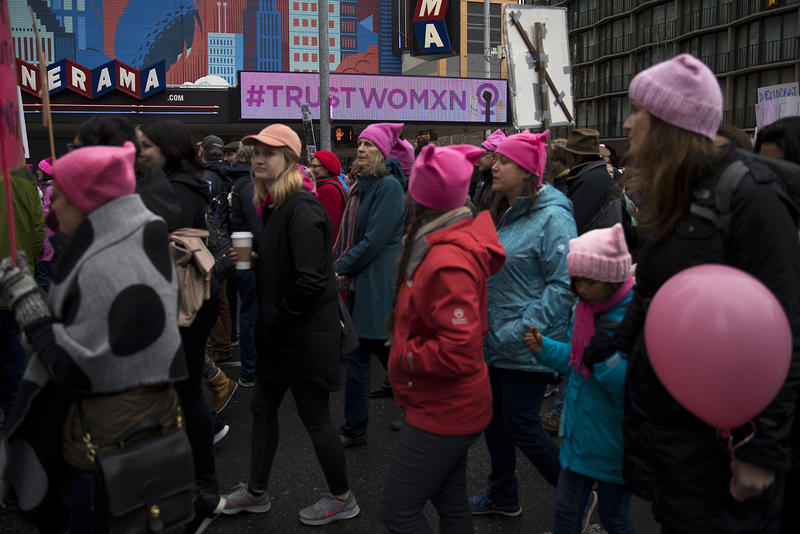 Crowds march on 4th Avenue during the Women's March on Saturday, January 20, 2018, in Seattle.