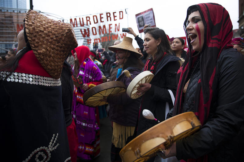 Raven Healing sings with Missing and Murdered Indigenous Women of Washington group members during the Women's March on Saturday, January 20, 2018, on Pine St., in Seattle.