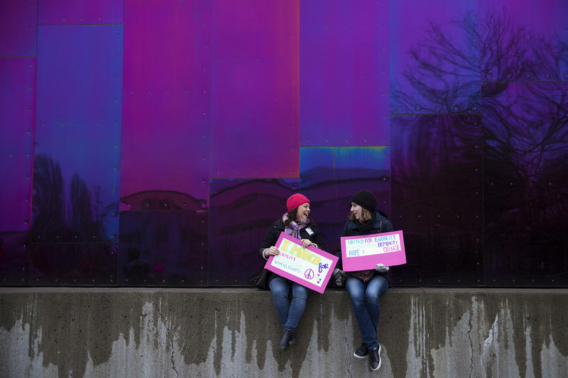 Jordana Miller and Kerry Rivers sit outside of the Museum of Pop Culture after the Women's March on Saturday, January 20, 2018, at Seattle Center.
