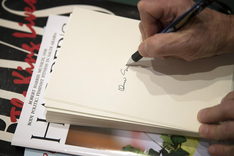 David Sedaris, signing one of more than 8,000 tip-ins. This is the hard labor that goes into your signed author copy.