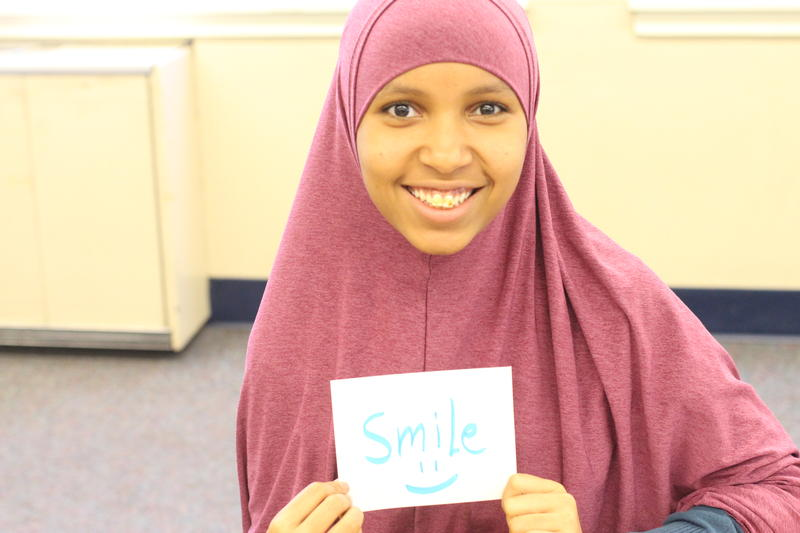 Asiya Jeylani smiles at the end of a RadioActive workshop.