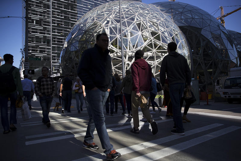 Pedestrians cross the street at Amazon headquarters in Seattle in September.