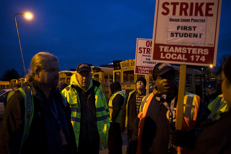 School bus drivers with Teamsters Local 174 strike on Thursday, Feb. 1, 2018, outside of the First Student bus lot on Lake City Way Northeast in Seattle.