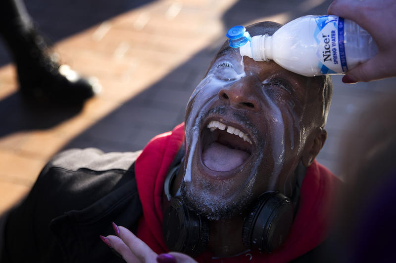 Jamal X has milk poured into his eyes after being pepper sprayed on Saturday, Feb. 10, 2018, while protesting a College Republicans rally at Red Square on the University of Washington campus in Seattle.