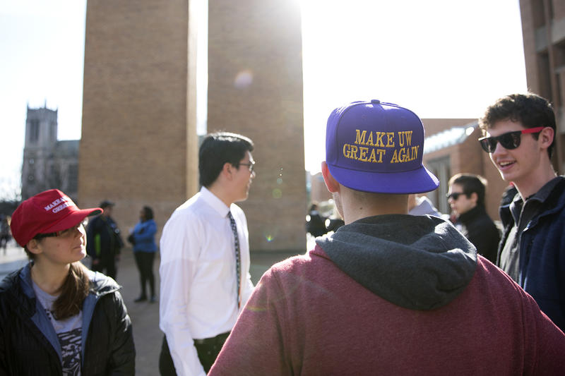 A student wears a 'Make UW Great Again' hat during a Collage Republicans rally on Saturday, Feb. 10, 2018, at Red Square on the University of Washington campus in Seattle.