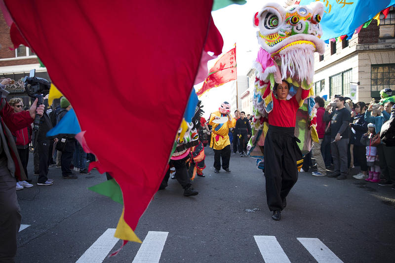 Members of the Master David F. Leong Dragon & Lion Group make their way to the main stage before performing the Lion Dance during the Lunar New Year celebration on Sunday, Feb. 11, 2018, in the Chinatown-International District in Seattle.