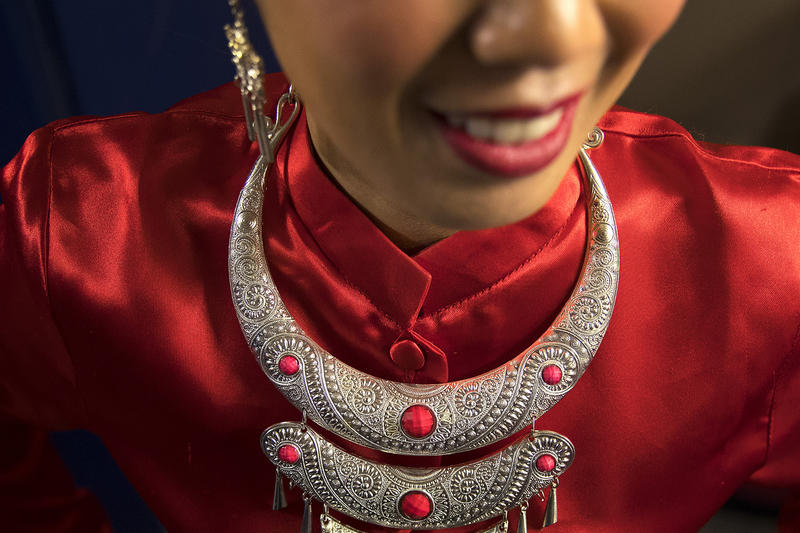 Thai Dance Team member Nattahanik Hall smiles while getting ready to perform during the Lunar New Year celebration on Sunday, Feb. 11, 2018, in the Chinatown-International District in Seattle.