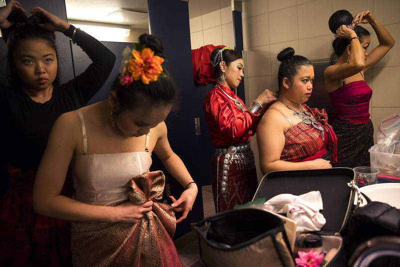 Members of the Thai Dance Team get ready in a bathroom before performing during the Lunar New Year celebration on Sunday, Feb. 11, 2018, in the Chinatown-International District in Seattle.
