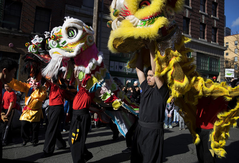 Members of the Master David F. Leong Dragon & Lion Group walk  after performing the Lion Dance during the Lunar New Year celebration on Sunday, Feb. 11, 2018, in the Chinatown-International District in Seattle.