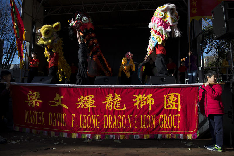Master David F. Leong Dragon & Lion Group members perform during the Lunar New Year celebration on Sunday, Feb. 11, 2018, in the Chinatown-International District in Seattle.