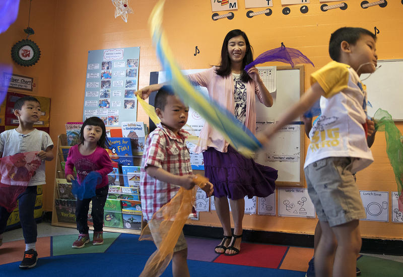 Seattle Preschool Program teacher Hien Do, center, dances with her students on Wednesday, June 28, 2017, at the ReWA Early Learning Center at Beacon, in Seattle, Washington.