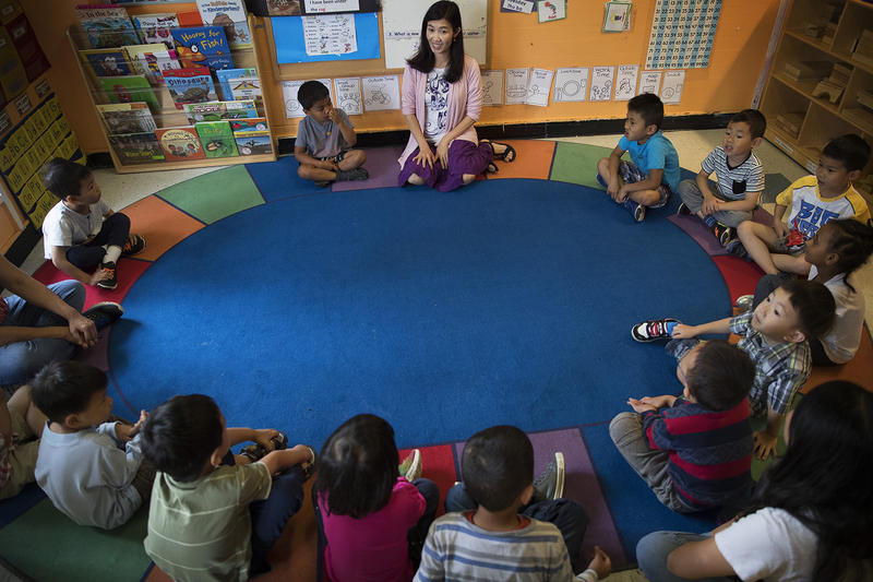 Seattle Preschool Program teacher Hien Do, center, sits in a circle with her students on Wednesday, June 28, 2017, at the ReWA Early Learning Center at Beacon, in Seattle, Washington.
