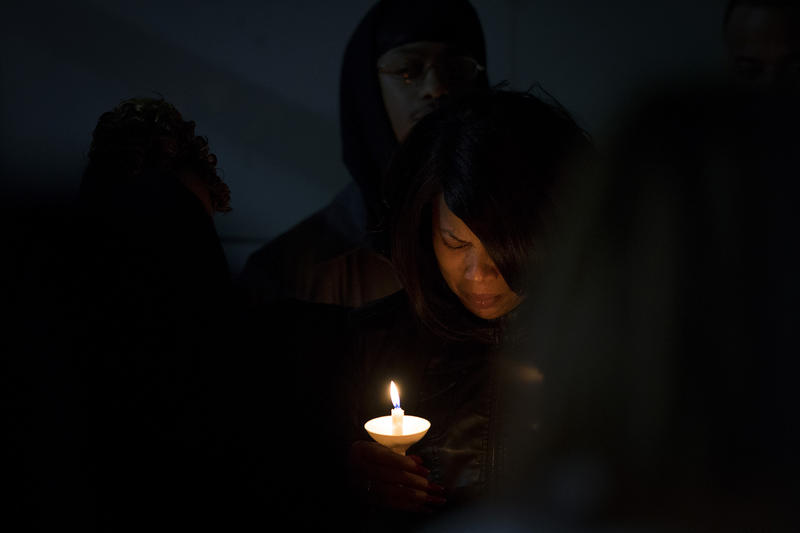 LaDonna Horne, center, holds a candle during a vigil honoring her son, DaShawn Horne, on Saturday, Feb. 3, 2018, at Harborview Park in Seattle.