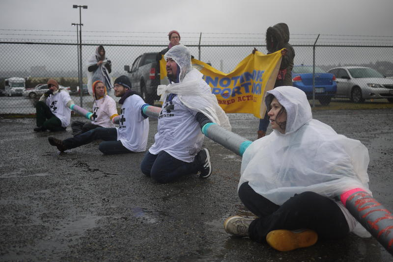 Maru Mora Villalpando, far right, joins a 2014 protest outside the Northwest Detention Center in Tacoma.