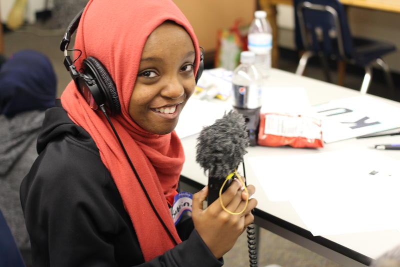 Sabrina Abdullahi from the Coalition for Refugees from Burma practices using a recorder.