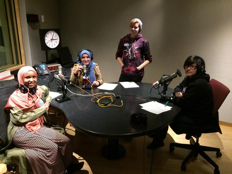 Coalition for Refugees from Burma participants Asiya Jeylani, Rafal Sultan, and Halli Cruz record their script in KUOW's studios.