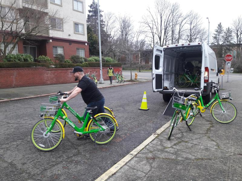 Limebike employees relocate bikes so that they're legally parked.